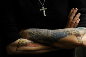 Biblical tattoos grace the arms of Nadia Bolz-Weber as she poses for a portrait, Friday, April, 22, 2011, at St. Thomas Episcopal Church in Denver, CO, where her will be moving. Nadia, of House For All Sinners and Saint, a is a rising star in the emergent church, very hip culturally and socially progressive, yet still theologically traditional Lutheran. She's been invited to preach the Easter sermon at Red Rocks this Easter. (Craig F. Walker/ The Denver Post)